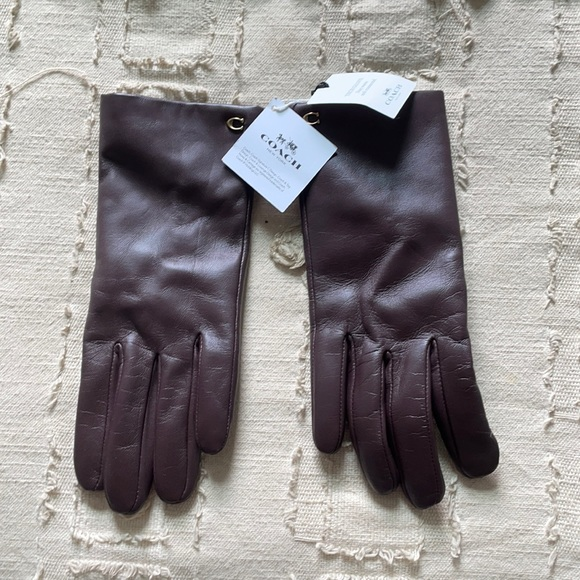 Brown Coach leather gloves with tags